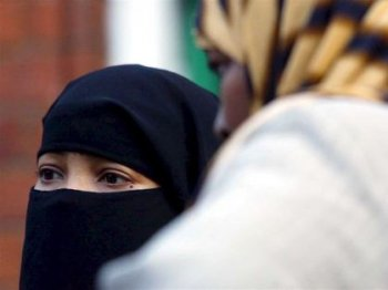 Birmingham college drops ban on face veils