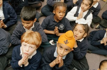Review law on collective worship in schools, say academics