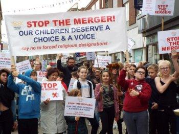 Parents protest plan to merge non-religious school into Christian one