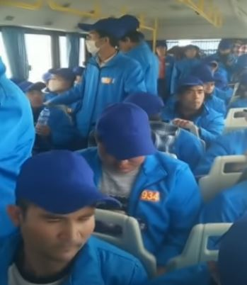 Uighur Muslims bussed across China