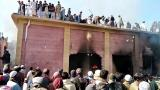 Pakistan arrests 14 after mob led by Islamist clerics sets Hindu temple on fire