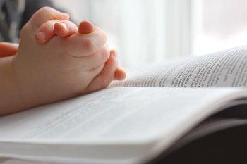 Child praying worship school